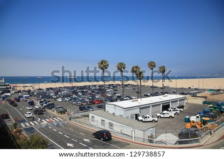 SANTA MONICA, CALIFORNIA - JULY 1: Santa Monica beachgoers and parking on July 1, 2012 in Santa Monica, California. The city has 3.5 miles of beach locations and averages 340 days of sunshine a year. - stock photo