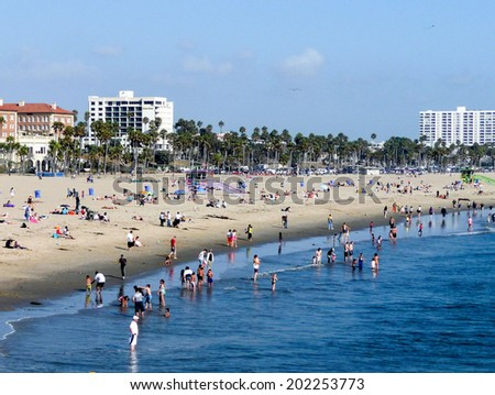 SANTA MONICA, CALIFORNIA - MAY 21, 2011: People enjoy the beach on a beautiful afternoon. Santa Monica Beach is a very famous attraction for locals and tourists. - stock photo