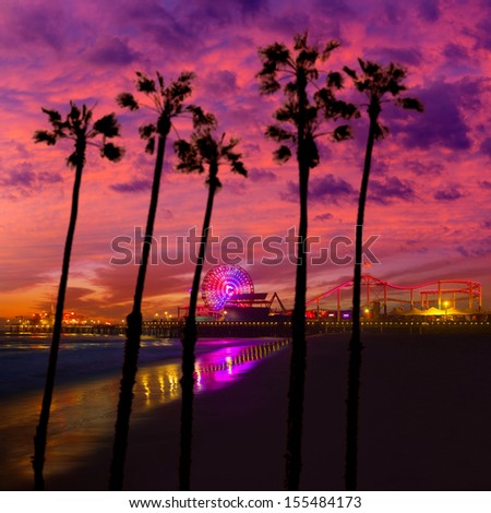 Santa Monica California sunset on Pier Ferris wheel and reflection on beach wet sand [photo illustration] - stock photo