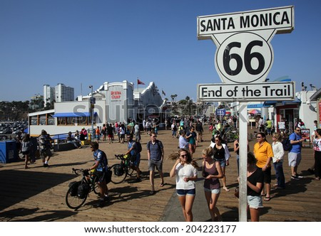 SANTA MONICA, CALIFORNIA - TUES. JUNE 24, 2014: A sign commemorates the end point of Route 66 in Santa Monica, California, on Tuesday, June 24, 2014. - stock photo