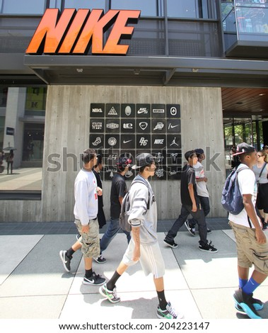 SANTA MONICA, CALIFORNIA - TUES. JUNE 24, 2014: Shoppers walk past a Nike sports clothing store in Santa Monica, California, on Tuesday, June 24, 2014. - stock photo