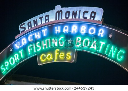 SANTA MONICA - JAN 14, 2015: Close Shot of Santa Monica Yacht Harbor Sport Fishing and Boating Sign in Los Angeles California at Night. Santa Monica is a beachfront city in Los Angeles California. - stock photo