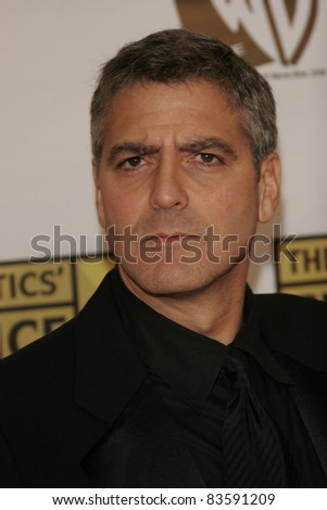 SANTA MONICA - JAN 9: George Clooney arrives at the11th annual Critics Choice Awards held at the Santa Monica Civic Center in Santa Monica, California on 9th January 2006 - stock photo