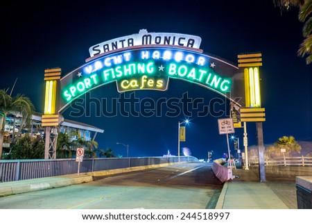 SANTA MONICA - JAN 14, 2015: Santa Monica Yacht Harbor Sign in Los Angeles California at Night. Santa Monica is a beachfront city in Los Angeles California. - stock photo