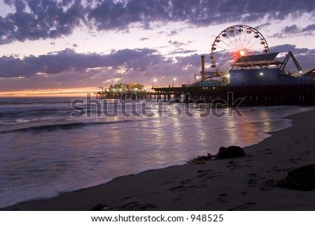 Santa Monica Pier during a beautiful California sunset. - stock photo