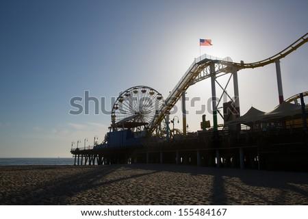 Santa Monica pier Ferris Wheel at sunset in California USA - stock photo