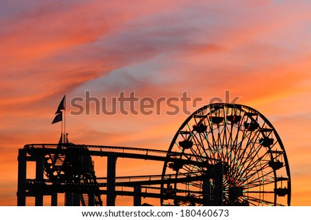 santa monica pier sunset silhouette - stock photo