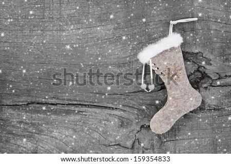 Santa or christmas boot on a wooden shabby chic background for a greeting card - stock photo