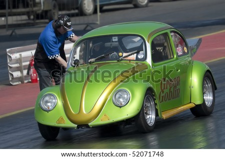 SANTA POD RACEWAY, UK - APRIL 23: Big Bang Camper and Bus Festival. The street legal Green Goblin VW Beetle on the quarter mile drag strip. Santa Pod Raceway, April 23, 2010 UK - stock photo