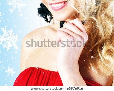 Santa posing on blue winter background with snowflakes - stock photo