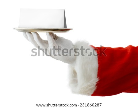 Santa presenting a silver platter with a blank card for copy space isolated on a white background - stock photo