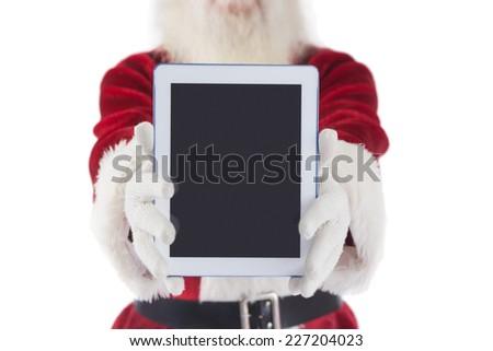 Santa presents a tablet PC on white background - stock photo