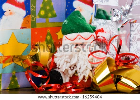 Santa puppet and decorated gift boxes with ribbons - stock photo