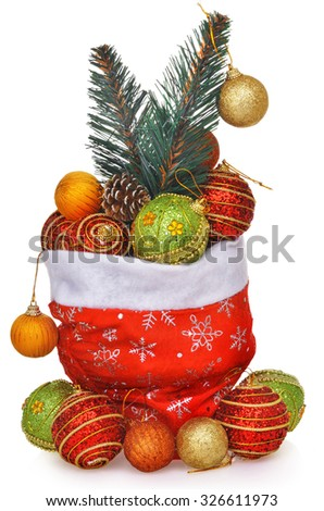 Santa's gift bag full of toys with christmas tree branch isolated over white - stock photo