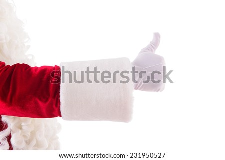 Santa's hand shows gesture the thumbs up.  Isolated on white background - stock photo