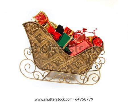 Santa's sleigh filled with colorful gift and toys - stock photo