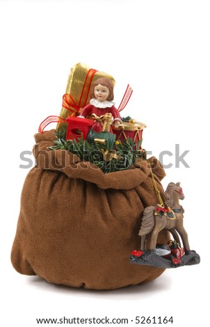 Santa's toy bag with doll, train, horse, drum and wrapped gift - stock photo