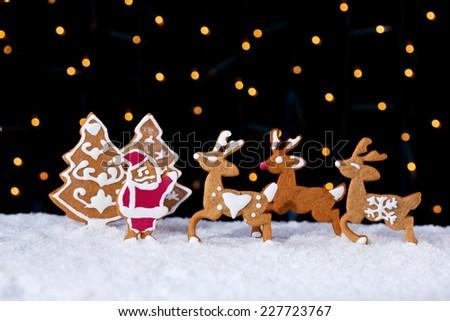 Santa welcoming his deers - food setting with gingerbread cookies - stock photo