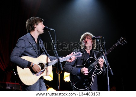 SANTANDER, SPAIN - JULY 22: Bjorn Dixgard (right) and Gustaf Nor�©n (left), singers and guitarists of Mando Diao band, performs at Santander Music Festival on July 22, 2011 in Santander, Spain. - stock photo