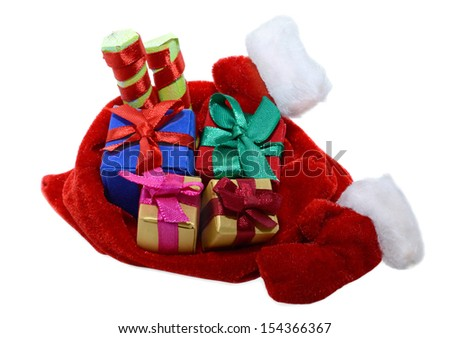 Santas red bag with gifts and furry mittens isolated - stock photo