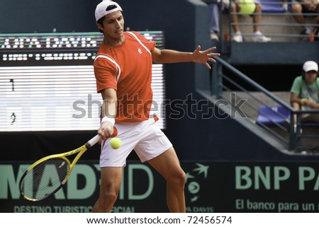 SANTIAGO, CHILE - MAR 4:  Paul Capdeville from Chile uses his forehand in the match against  Jhon Isner during the second match valid for the Davis Cup. March 4, 2011 in Santiago Chile. - stock photo
