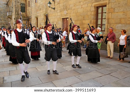 SANTIAGO DE COMPOSTELA, SPAIN - AUGUST 13, 2010: Musicians and pilgrims in the square before the cathedral in Santiago de Compostela, Galicia. Camino de Santiago is World Heritage Site by UNESCO - stock photo