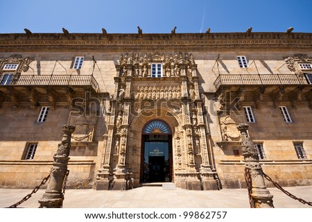 SANTIAGO DE COMPOSTELA, SPAIN - MAY 22 Hostal de los Reyes Catolicos in Santiago de Compostela on May 22, 2011. Founded in 1499 as a hostel for pilgrims who had ended the Way of Saint James. - stock photo