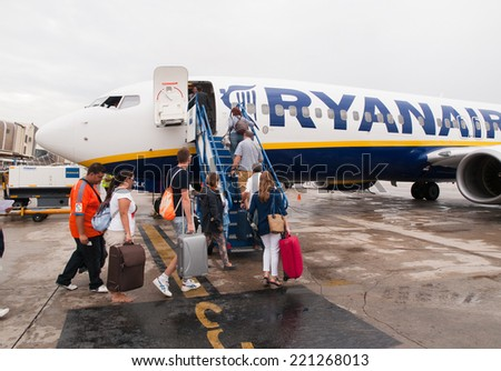 SANTIAGO DE COMPOSTELA, SPAIN - SEPTEMBER 22 Plane of Ryanair airline during passenger boarding, in Santiago de Compostela, Spain, on September 22, 2014. Ryanair airline is an irish company. - stock photo