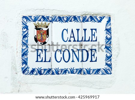 SANTO DOMINGO, DOMINICAN REPUBLIC - MARCH 11  Close up of El Conde street sign, this is the main pathway of the Colonial Zone Historical District on March 11, 2011 in Sto Domingo, Dominican Republic. - stock photo