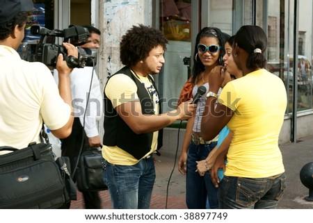 SANTO DOMINGO - OCTOBER 9: Media Correspondents in action during Dominican Republic's weekend street celebrations October 9, 2009 in Santo Domingo, Dominican Republic. - stock photo