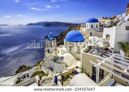 Santorini blue dome churches, Greece - stock photo