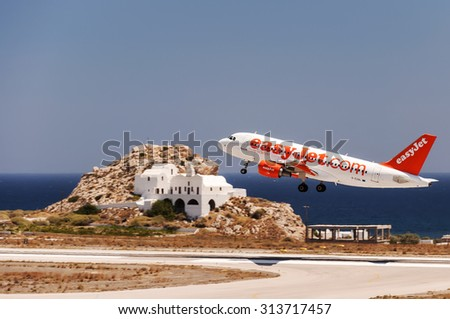 SANTORINI, GREECE - July 10, 2011: easy jet low cost airline, Airbus A320 aircraft departing from International Airport 'Santorini', Greece. - stock photo