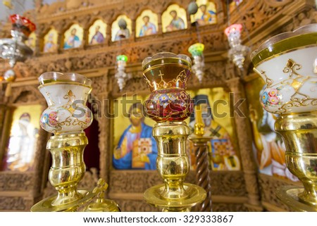 SANTORINI, GREECE, JULY 25: Several religious icons of Jesus and his priests in a orthodox church, Santorini, Greece 2013 - stock photo