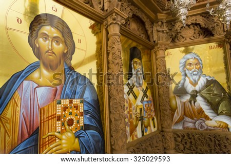 SANTORINI, GREECE, JULY 25: Several religious icons of Jesus and his priests inside an Orthodox church, Santorini, Greece 2013. - stock photo