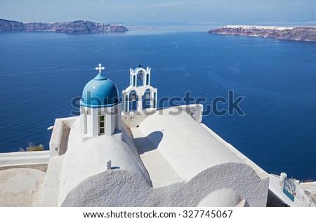 Santorini - The look to typically little church Theoskepasti in Imerovigli under the Scaros. - stock photo