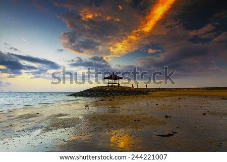 Sanur beach in bali with sunrise early morning. (soft focus, shallow DOF, slight motion blur) - stock photo