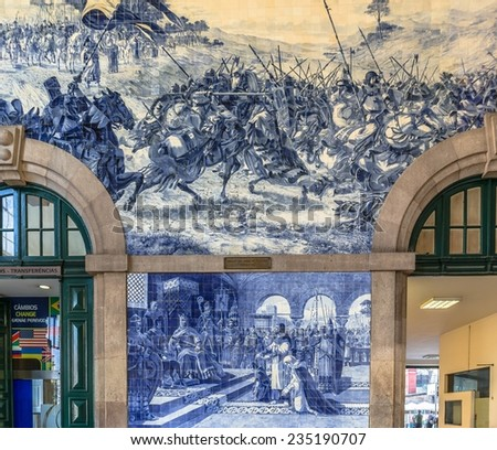Sao Bento station with tiles representing Portugal history. - stock photo