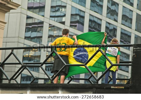 SAO PAULO, BRAZIL - APRIL 12, 2015: Two unidentified kids with brazilian flag at protest against federal government corruption in Sao Paulo Brazil. Protesters call for the impeachment of President - stock photo
