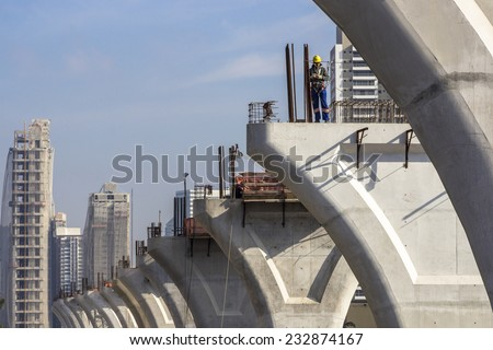 SAO PAULO, BRAZIL, APRIL 25, 2013: Workers in the construction of the elevated metro track, on Roberto Marinho Avenue, in Sao Paulo. Brazil - stock photo