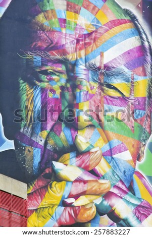 SAO PAULO, BRAZIL  FEBRUARY 08, 2015: A big and color mural on the wall from Brazilian graffiti artist Kobra at Paulista Avenue in Sao Paulo Brazil. - stock photo