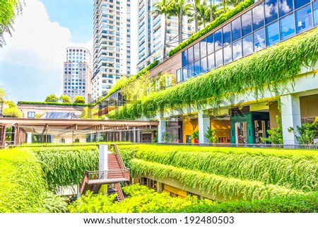 SAO PAULO, BRAZIL- FEBRUARY 19: Ecologic building with plants on the external part on February 19, 2014 in Sao Paulo, Brazil. The green areas contribute to the cooling of the building. - stock photo