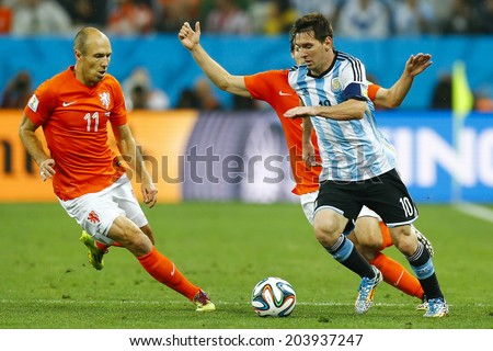 SAO PAULO, BRAZIL - July 9, 2014: Messi of Argentina and Robben of Netherlands compete for the ball during the game between Netherlands and Argentina at Arena Corinthians. NO USE IN BRAZIL. - stock photo