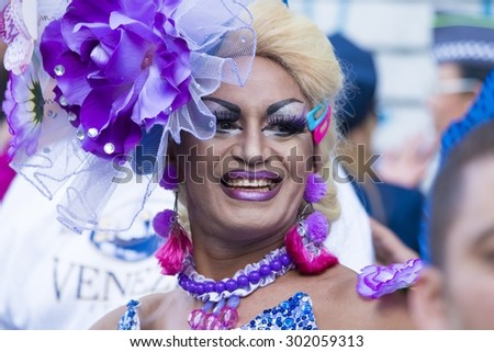 SAO PAULO, BRAZIL - June 7, 2015: An unidentified Drag Queen dressed in a costume celebrating lesbian, gay, bisexual, and transgender culture in the 19th Gay Pride Parade Sao Paulo - stock photo