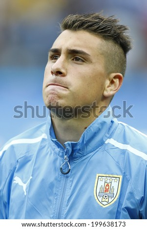 SAO PAULO, BRAZIL - June 19, 2014: Jose Gimenez during Uruguay National Anthem at the 2014 World Cup Group D game between Uruguay and England at Arena Corinthians, Itaquerao. No Use in Brazil. - stock photo