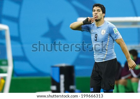SAO PAULO, BRAZIL - June 19, 2014: Luis Suarez of Uruguay celebrates after scoring a goal during the 2014 World Cup Group D game between Uruguay and England at Arena Corinthians. No Use in Brazil. - stock photo