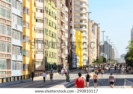 Sao Paulo, Brazil, June 14, 2015: People have fun in a high road, closed to cars on Sundays and holidays, in downtown Sao Paulo - stock photo