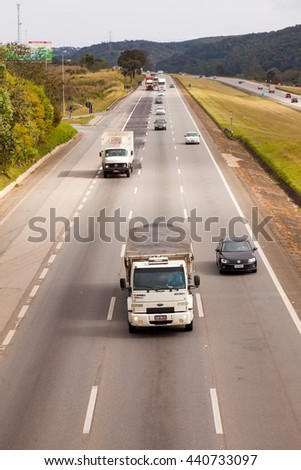 SAO PAULO, BRAZIL - JUNE 20, 2016 - Vehicles on BR-374 highway with headlights on during the daylight obeying the new Brazilian transit laws - stock photo