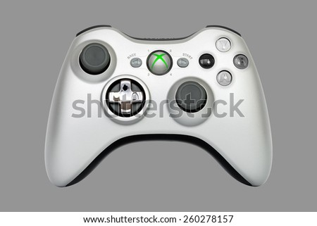SAO PAULO, BRAZIL - MAR 13, 2014: The wireless gamepad for the Xbox 360, a home video game console produced by Microsoft, isolated on 50% grey background. - stock photo