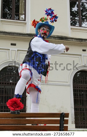 SAO PAULO, BRAZIL - MARCH 8, 2015: An unidentified funny clown with typical costumes on the streets of Sao Paulo Brazil. - stock photo