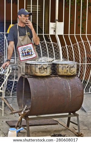 SAO PAULO, BRAZIL - MAY 17, 2015: An unidentified Man make  food at street fair market in Sao Paulo.  - stock photo